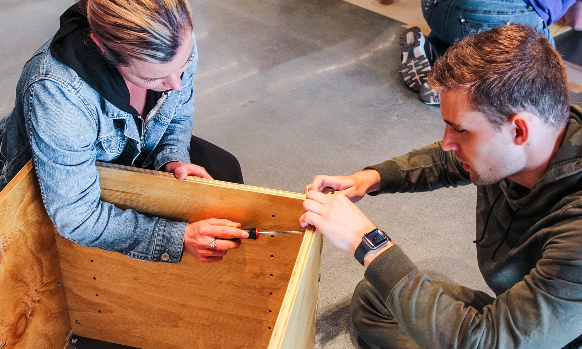 A woman and man building shelves together